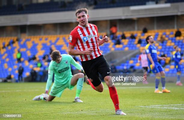 Charlie Wyke of Sunderland celebrates scoring the 3rd goal during the Sky Bet League One match between AFC Wimbledon and Sunderland at Plough Lane on...