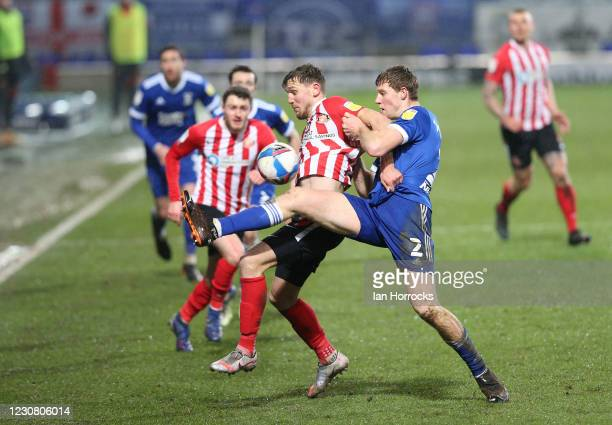 Charlie Wyke of Sunderland competes with Mark McGuinnes of Ipswich during the Sky Bet League One match between Ipswich Town and Sunderland at Portman...