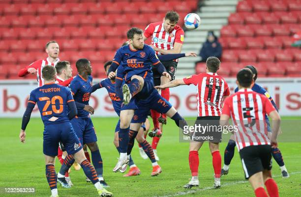 Charlie Wyke of Sunderland heads into the keepers arms during the Sky Bet League One match between Sunderland and Blackpool at Stadium of Light on...