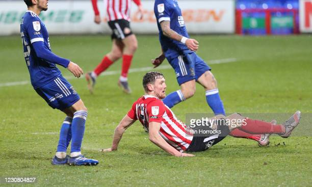 Charlie Wyke of Sunderland slides in to score the opening goal during the Sky Bet League One match between Ipswich Town and Sunderland at Portman...