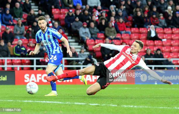 Charlie Wyke of Sunderland stretches for the ball during the Sky Bet Leauge One match between Sunderland and Blackpool at Stadium of Light on...