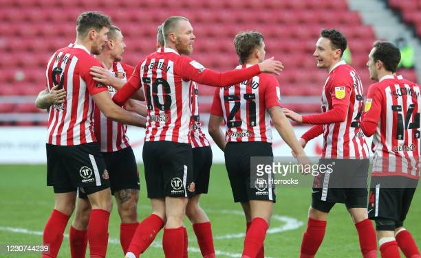 Charlie Wyke of Sunderland turns to celebrate with his team after he heads in the opening goal during the Sky Bet League One match between Sunderland...