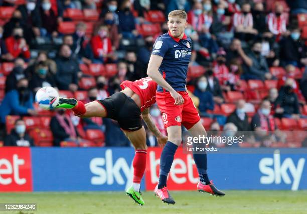 Charlie Wyke of Sunderland wins a header during the Sky Bet League One Play-off Semi Final 1st Leg match between Lincoln City and Sunderland at LNER...