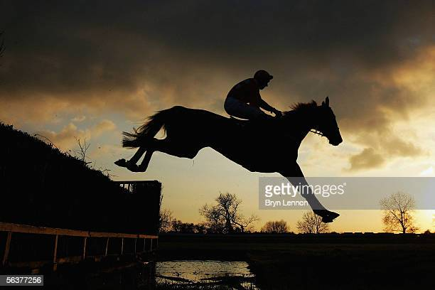 Charliemore ridden by Eddie Deahdashti is seen in action during the Racing UK Novices' Handicap Steeple Chase at Huntingdon Race Course on December 8...