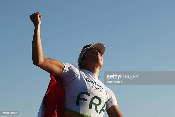 Charline Picon of France celebrate winning the gold medal in the Women's RSX class on Day 9 of the Rio 2016 Olympic Games at the Marina da Gloria on...
