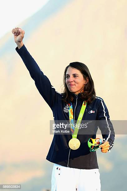 Charline Picon of France celebrates after winning the gold medal in the Women's RSX class on Day 9 of the Rio 2016 Olympic Games at the Marina da...
