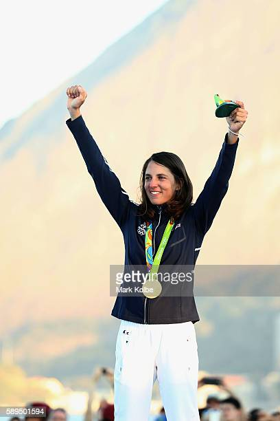 Charline Picon of France celebrates on the podium after winning the gold medal in the Women's RSX class on Day 9 of the Rio 2016 Olympic Games at the...
