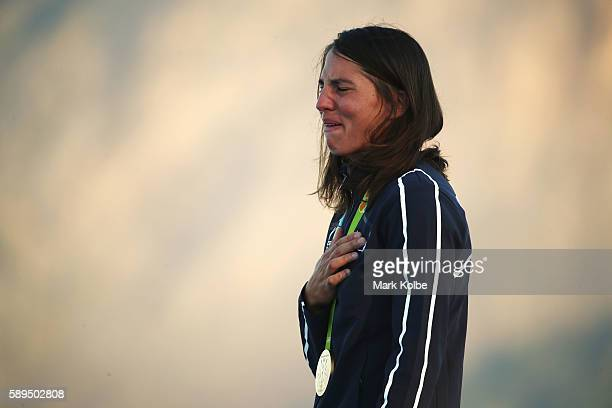 Charline Picon of France reacts on the podium after winning the gold medal in the Women's RSX class on Day 9 of the Rio 2016 Olympic Games at the...