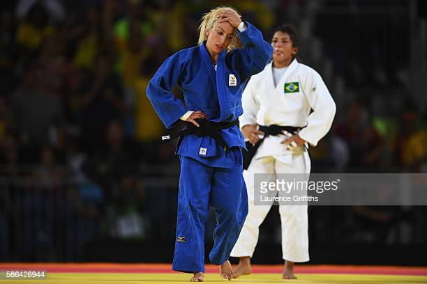 Charline van Snick of Belgium reacts after being defeated by Sarah Menezes of Brazil in the women's -48 kg Judo on Day 1 of the Rio 2016 Olympic...