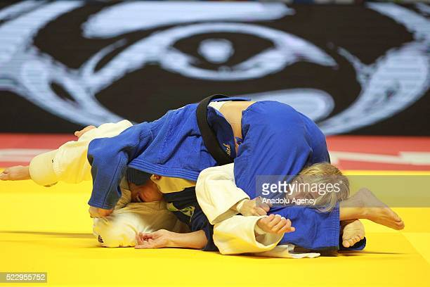 Charline Van Snick of the Belgium in action against Eva Csernoviczki of Hungary in their final bout of the women's 48 kg category at the Judo...