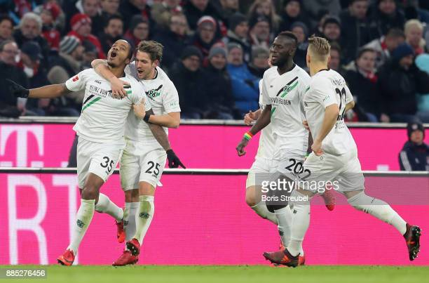 Charlison Benschop of Hannover 96 celebrates with team mates after scoring his team's first goal during the Bundesliga match between FC Bayern...
