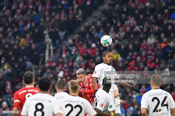 Charlison Benschop of Hannover and Robert Lewandowski of Bayern Muenchen jump for a header during the Bundesliga match between FC Bayern Muenchen and...