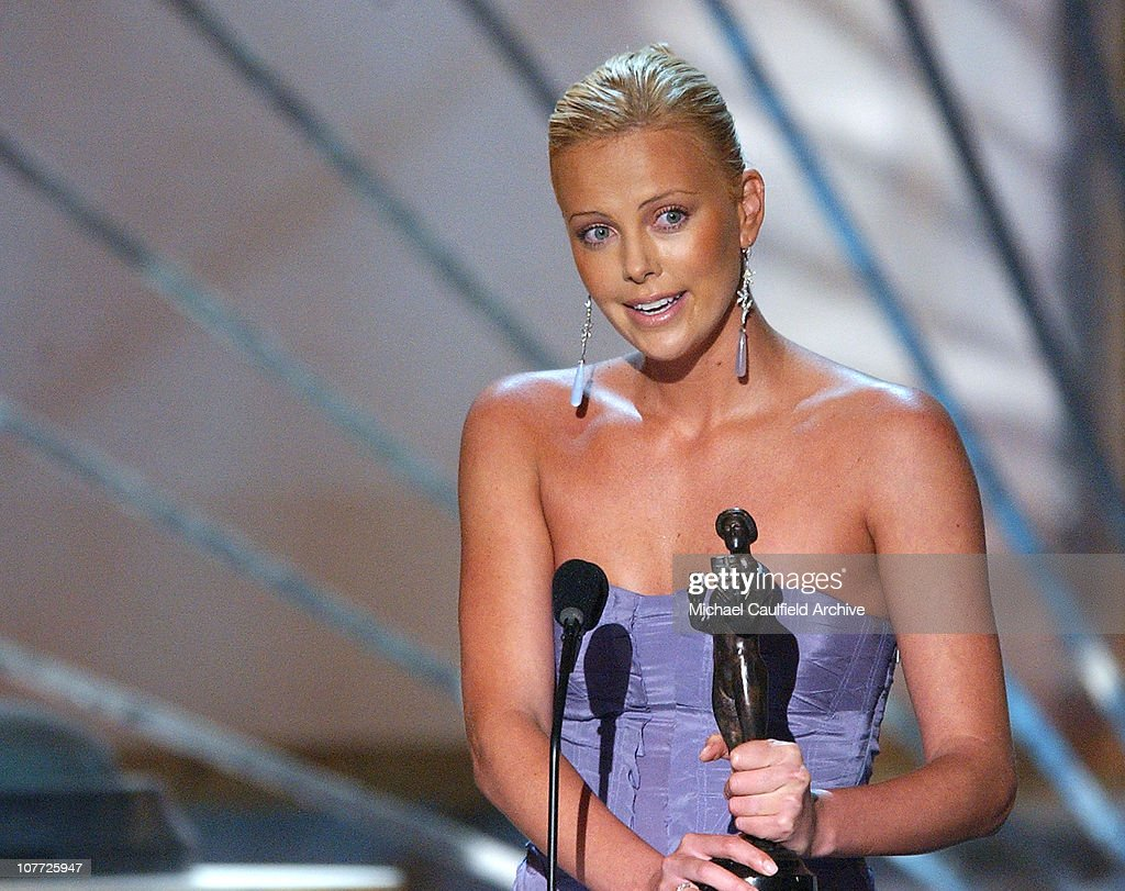 Charlize Theron accepts for Outstanding Female Actor in a Motion Picture Award for 'Monster'