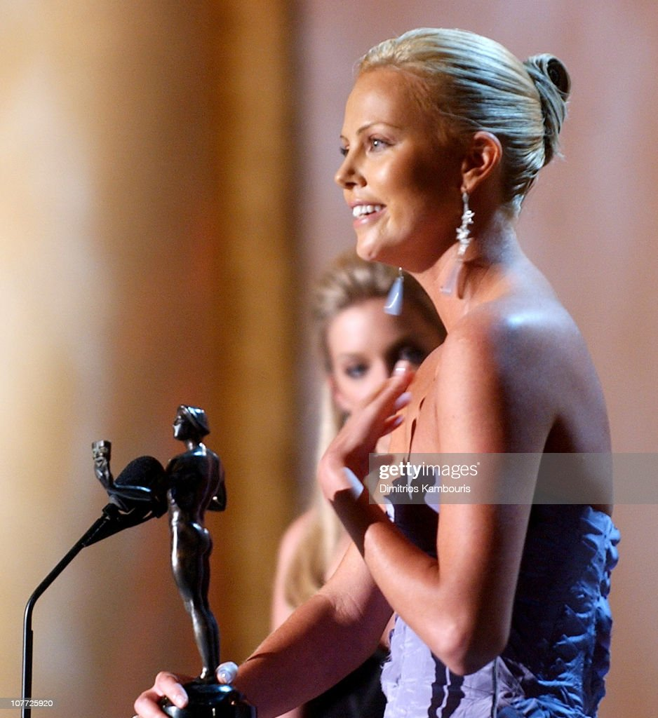 Charlize Theron accepts the award for Outstanding Female Actor in a Lead Role for 'Monster'