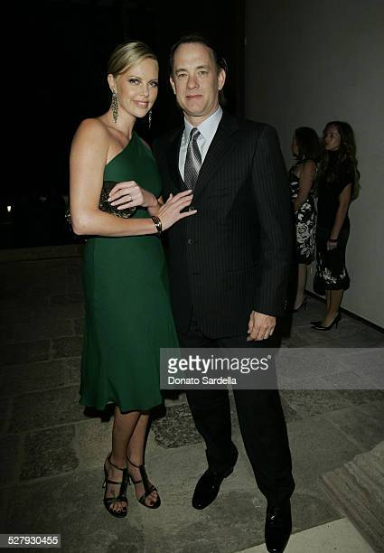 Charlize Theron an Tom Hanks during Gucci Spring 2006 Fashion Show to Benefit Children's Action Network and Westside Children's Center Inside at...