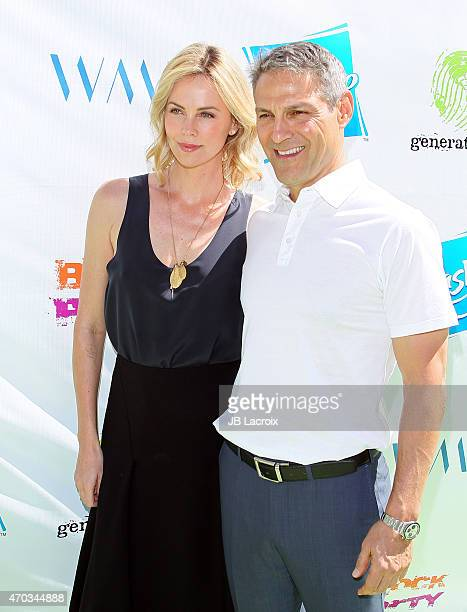 Charlize Theron and Ari Emanuel attend the generationOn West Coast Block Party on April 18 2015 in Beverly Hills California