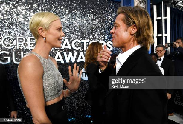 Charlize Theron and Brad Pitt attend the 26th Annual Screen ActorsGuild Awards at The Shrine Auditorium on January 19 2020 in Los Angeles California...