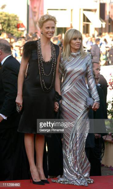Charlize Theron and Britt Ekland during 2004 Cannes Film Festival 'The Life and Death of Peter Sellers' Premiere at Palais Du Festival in Cannes...