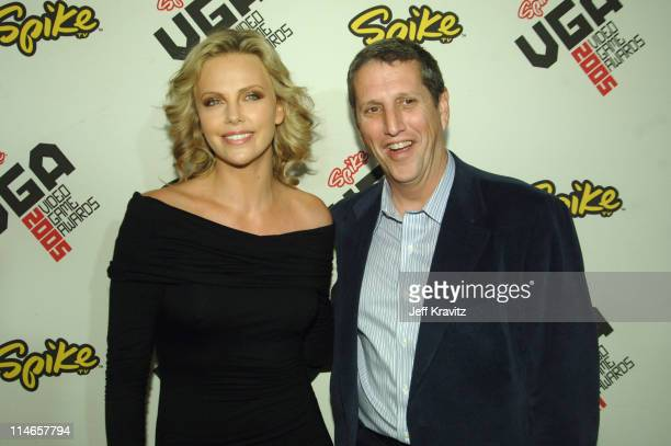 Charlize Theron and Doug Herzog during 2005 Spike TV Video Game Awards - Red Carpet at Gibson Amphitheater in Universal City, California, United...