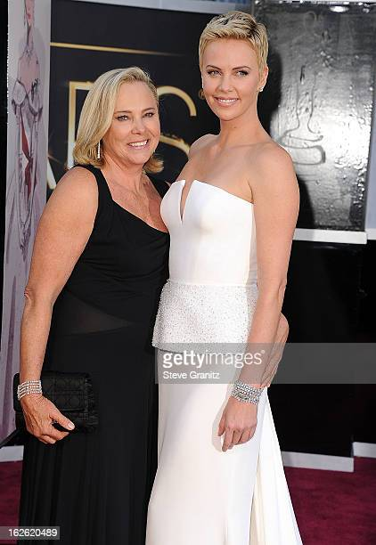 Charlize Theron and Gerda Jacoba Aletta Maritz arrives at the 85th Annual Academy Awards at Dolby Theatre on February 24 2013 in Hollywood California