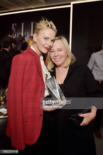 Charlize Theron and Gerda Jacoba Aletta Maritz attend ELLE's 25th Annual Women In Hollywood Celebration presented by L'Oreal Paris Hearts On Fire and...