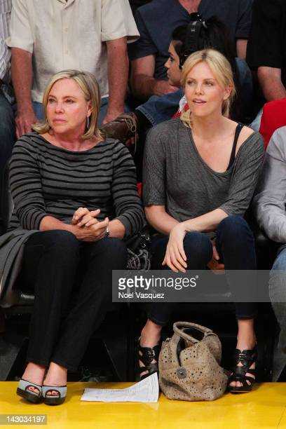 Charlize Theron and her mother Gerda attend a basketball game between the San Antonio Spurs and the Los Angeles Lakers at Staples Center on April 17...