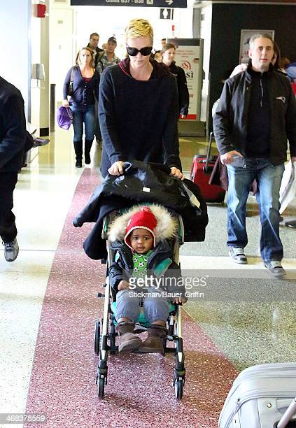 Charlize Theron and her son Jackson Theron are seen arriving at Logan International Airport on March 16 2013 in Boston Massachusetts
