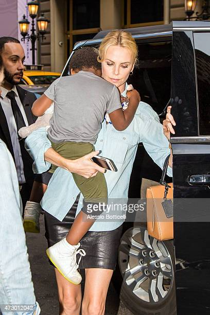 Charlize Theron and her son Jackson Theron are seen having dinner at The Polo Bar on May 11 2015 in New York City