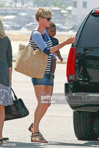 Charlize Theron and her son Jackson Theron are seen on August 06 2013 in Los Angeles CA