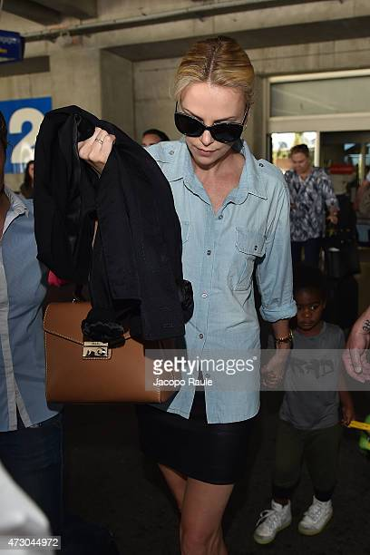 Charlize Theron and her son Jackson Theron arrive at Nice Airport during the 68th annual Cannes Film Festival on May 12 2015 in Cannes France