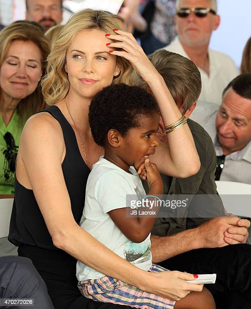 Charlize Theron and Jackson Theron attend the generationOn West Coast Block Party on April 18 2015 in Beverly Hills California