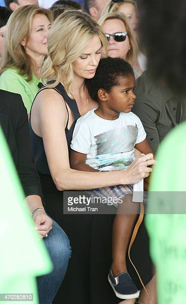 Charlize Theron and Jackson Theron attend the generationOn West Coast Block Party held at Fox Studio Lot on April 18 2015 in Century City California