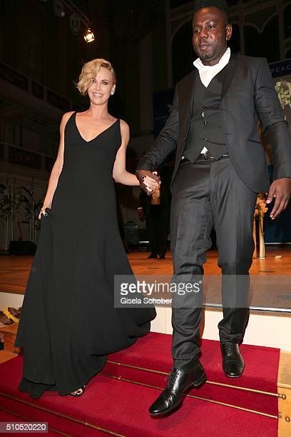 Charlize Theron and Kweku Mandela grandson of Nelson Mandela during the Cinema For Peace Gala 2016 during the 66th Berlinale International Film...