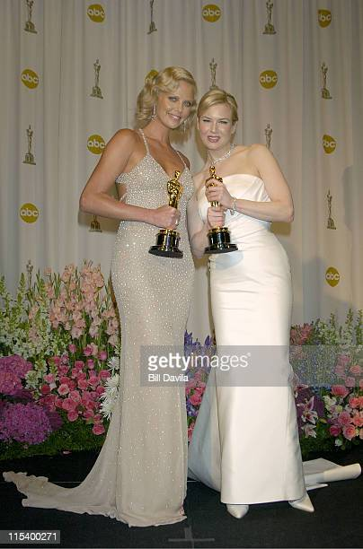 Charlize Theron and Renee Zellweger during The 76th Annual Academy Awards - Press Room at Kodak Theater at Hollywood and Highland in Hollywood,...