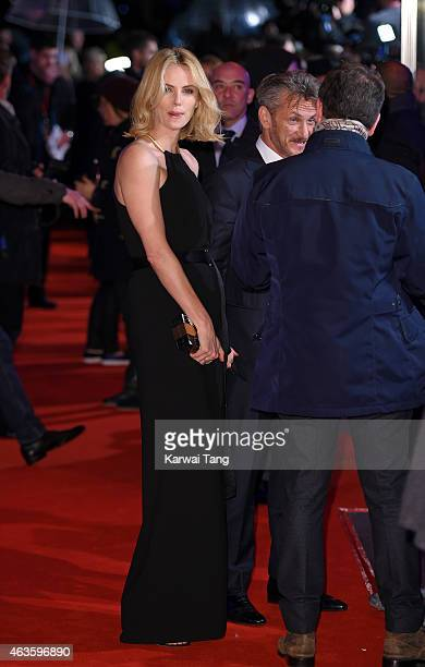 """Charlize Theron and Sean Penn attend the World Premiere of """"The Gunman"""" at BFI Southbank on February 16, 2015 in London, England."""