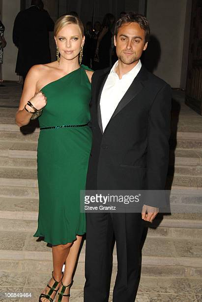 Charlize Theron and Stuart Townsend during Gucci Spring 2006 Fashion Show to Benefit Children's Action Network and Westside Children's Center...