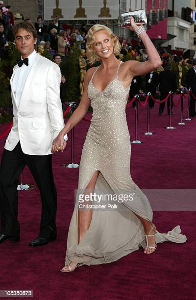 Charlize Theron and Stuart Townsend during The 76th Annual Academy Awards Arrivals by Chris Polk at Kodak Theatre in Hollywood California United...