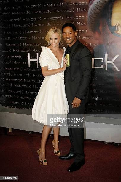 Charlize Theron and Will Smith attends the Paris Premiere of Hancock on June 16, 2008 at L'Olympia Hall in Paris, France.