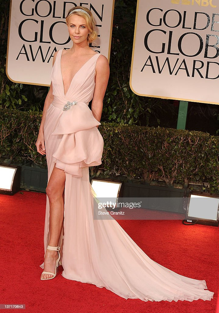 ce8aa1104b676 Charlize Theron arrives at the 69th Annual Golden Globe Awards at ...