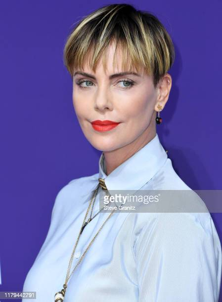 Charlize Theron arrives at the Premiere Of MGM's The Addams Family at Westfield Century City AMC on October 06 2019 in Los Angeles California