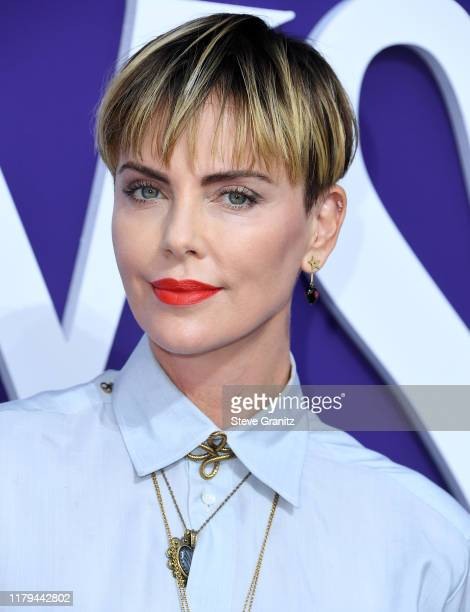 """Charlize Theron arrives at the Premiere Of MGM's """"The Addams Family"""" at Westfield Century City AMC on October 06, 2019 in Los Angeles, California."""