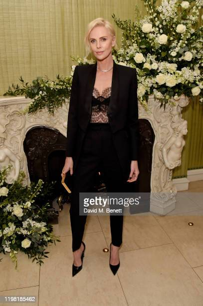 Charlize Theron attends the British Vogue and Tiffany Co Fashion and Film Party at Annabel's on February 2 2020 in London England