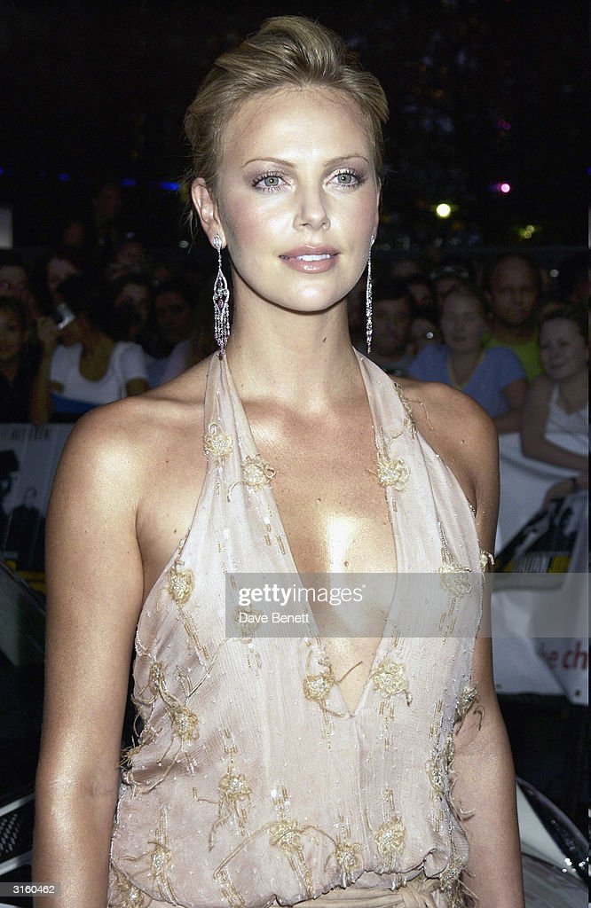 Charlize Theron attends the UK Premiere of 'The Italian Job' at the Empire West End on September 16, 2003 in London.