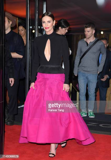 "Charlize Theron departs after attending the ""Long Shot"" special screening at Curzon Cinema Mayfair on April 25, 2019 in London, England."