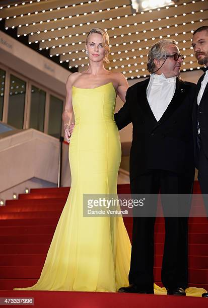 "Charlize Theron, George Miller and Tom Hardy leave the ""Mad Max : Fury Road"" Premiere during the 68th annual Cannes Film Festival on May 14, 2015 in..."