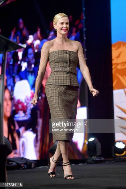Charlize Theron is seen onstage during the 31st Annual Palm Springs International Film Festival Film Awards Gala at Palm Springs Convention Center on...