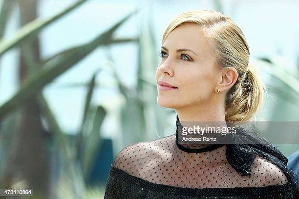 Charlize Theron looks up after she leaves a photocall for 'Mad Max Fury Road' during the 68th annual Cannes Film Festival on May 14 2015 in Cannes...