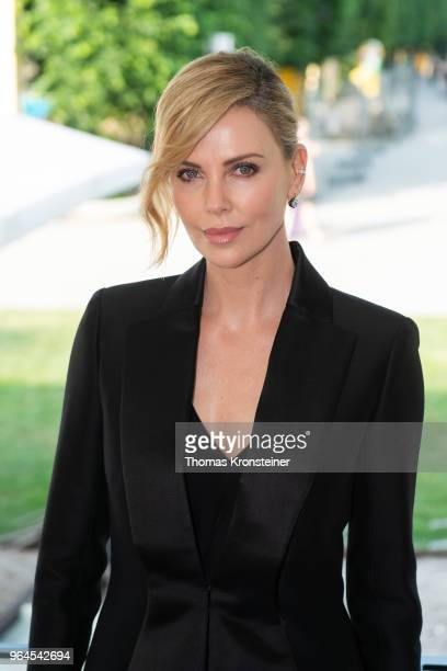 Charlize Theron poses before receiving the Swarovski Crystal of Hope award for the Charlize Theron Africa Outreach Project at Kaiserpavillon At...