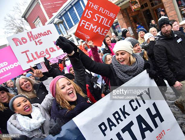 Charlize Theron poses during the Women's March on Main Street Park City on January 21 2017 in Park City Utah