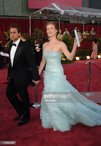 Charlize Theron, presenter and Stuart Townsend during The 77th Annual Academy Awards - Arrivals at Kodak Theatre in Los Angeles, California, United...